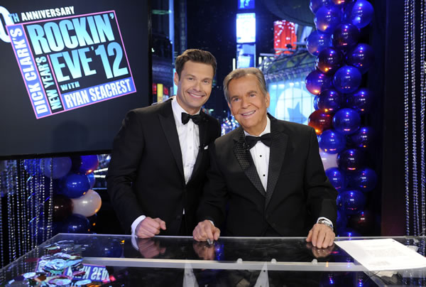 In this Dec. 31, 2011 photo released by ABC, hosts Dick Clark, right, and Ryan Seacrest pose on the set of