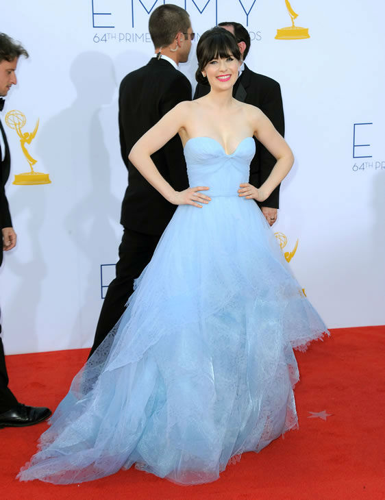 Actress Zooey Deschanel arrives at the 64th Primetime Emmy Awards at the Nokia Theatre on Sunday, Sept. 23, 2012, in Los Angeles. (Photo by Jordan Strauss/Invision/AP)