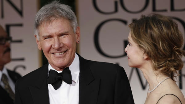 Harrison Ford, left, and Calista Flockhart arrive at the 69th Annual Golden Globe Awards Sunday, Jan. 15, 2012, in Los Angeles. (AP Photo/Matt Sayles)
