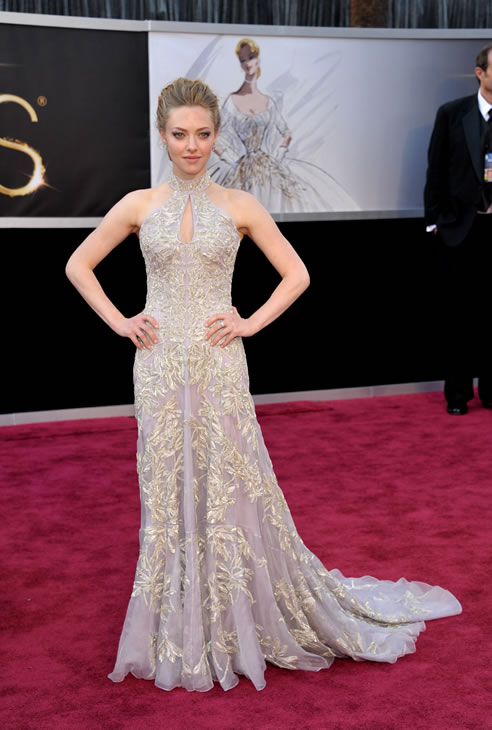 Actress Amanda Seyfried arrives at the 85th Academy Awards at the Dolby Theatre on Sunday Feb. 24, 2013, in Los Angeles. (Photo by John Shearer/Invision/AP)