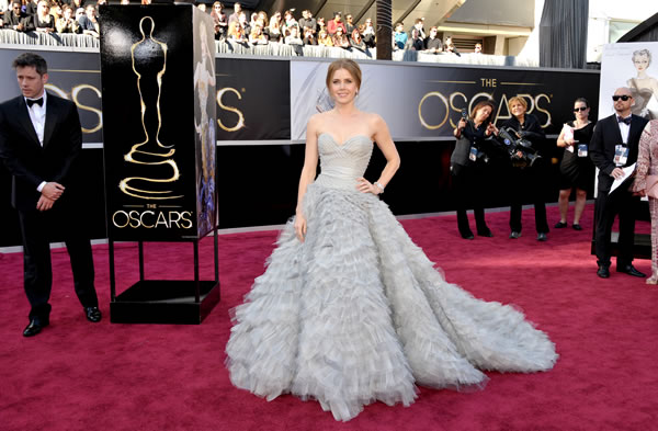 "<div class=""meta ""><span class=""caption-text "">Actress Amy Adams arrives at the 85th Academy Awards at the Dolby Theatre on Sunday Feb. 24, 2013, in Los Angeles. (Photo by John Shearer/Invision/AP)</span></div>"