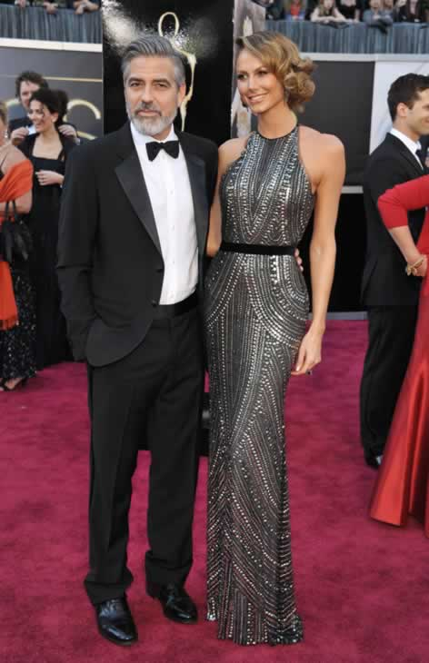 "<div class=""meta ""><span class=""caption-text "">Actor George Clooney, left, and Stacy Keibler arrive at the Oscars at the Dolby Theatre on Sunday Feb. 24, 2013, in Los Angeles. (Photo by John Shearer/Invision/AP)</span></div>"