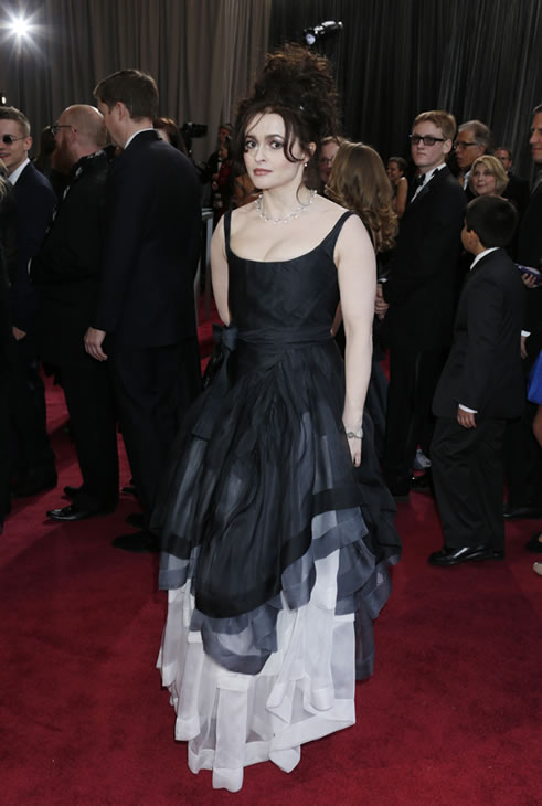 Actress Helena Bonham Carter arrives at the Oscars at the Dolby Theatre on Sunday Feb. 24, 2013, in Los Angeles. (Photo by Todd Williamson/Invision/AP)