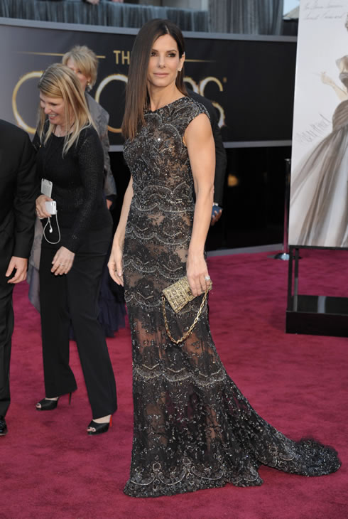 "<div class=""meta ""><span class=""caption-text "">Actress Sandra Bullock arrives at the Oscars at the Dolby Theatre on Sunday Feb. 24, 2013, in Los Angeles. (Photo by John Shearer/Invision/AP)</span></div>"