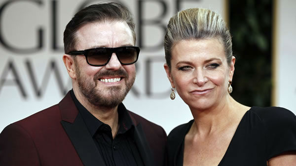 Ricky Gervais and Jane Fallon arrive for the 69th Annual Golden Globe Awards Sunday, Jan. 15, 2012, in Los Angeles. (AP Photo/Matt Sayles)