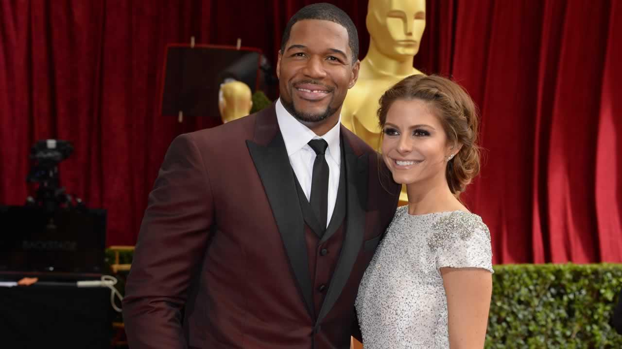Michael Strahan, left, and Maria Menounos arrive at the Oscars.