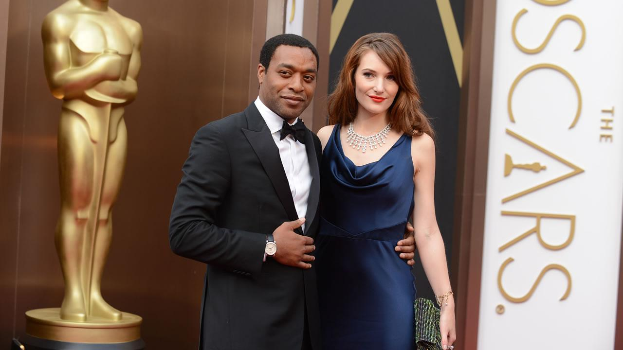 Chiwetel Ejiofor, left, and Sari Mercer arrive at the Oscars.