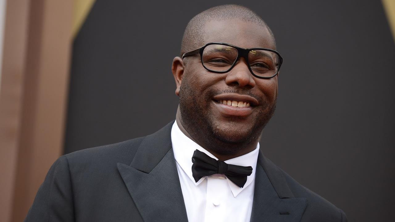 Director Steve McQueen arrives at the Oscars.