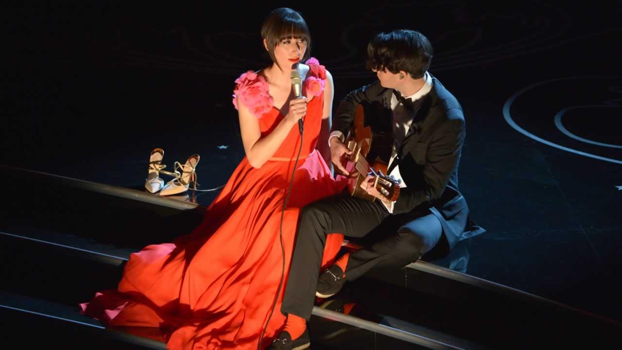 Karen O, left, and Ezra Koenig perform during the Oscars.
