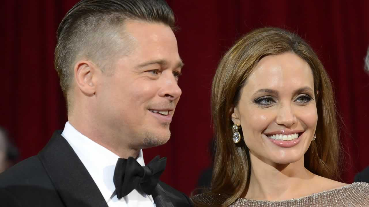Brad Pitt, left, and Angelina Jolie arrive at the Oscars.