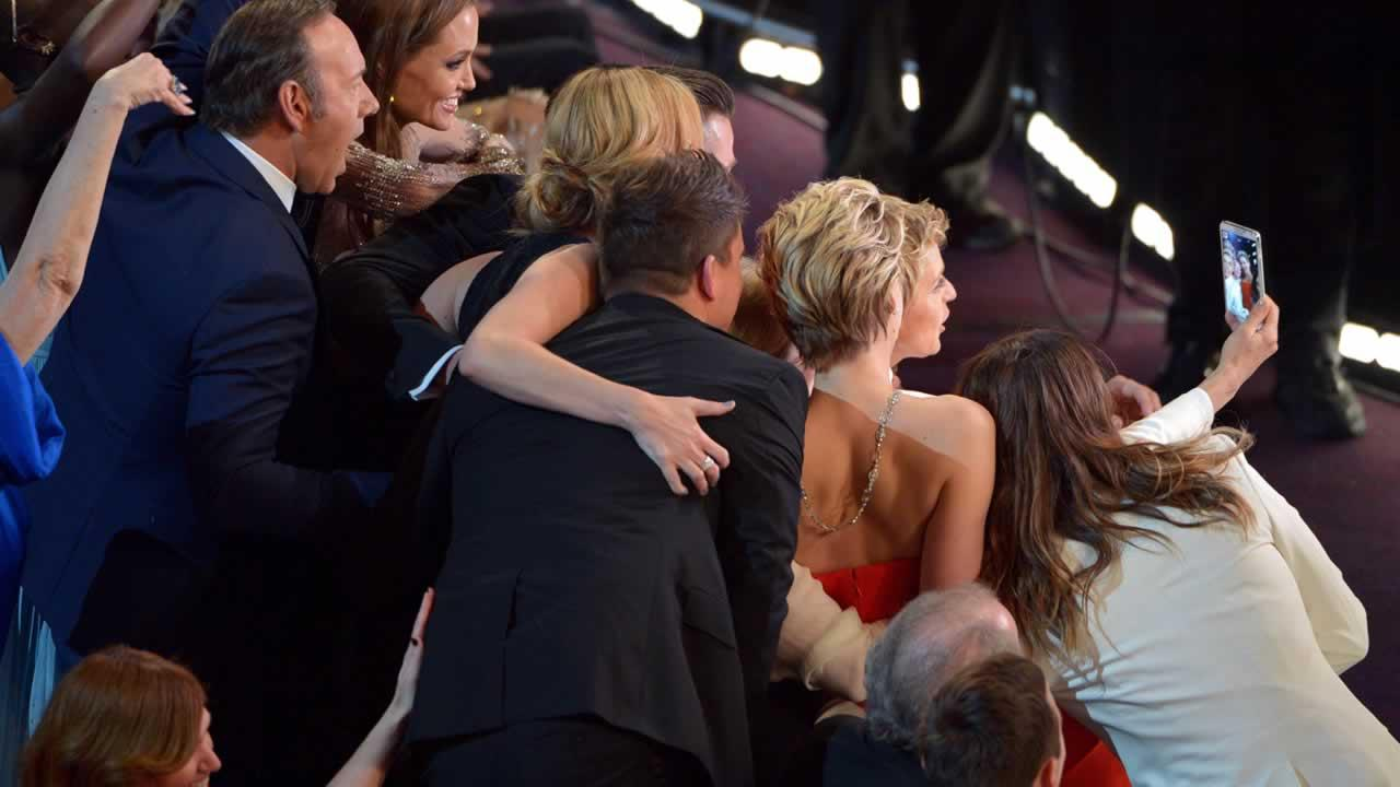 Kevin Spacey, from left, Angelina Jolie, Julia Roberts, Brad Pitt, Jennifer Lawrence, Ellen Degeneres and Jared Leto join other celebrities for a selfie.