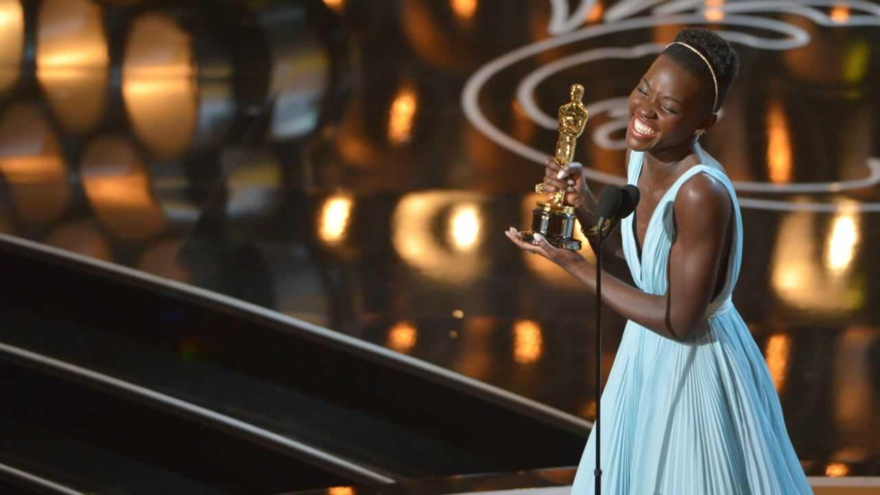Lupita Nyongo accepts the award for best actress in a supporting role for 12 Years a Slave.