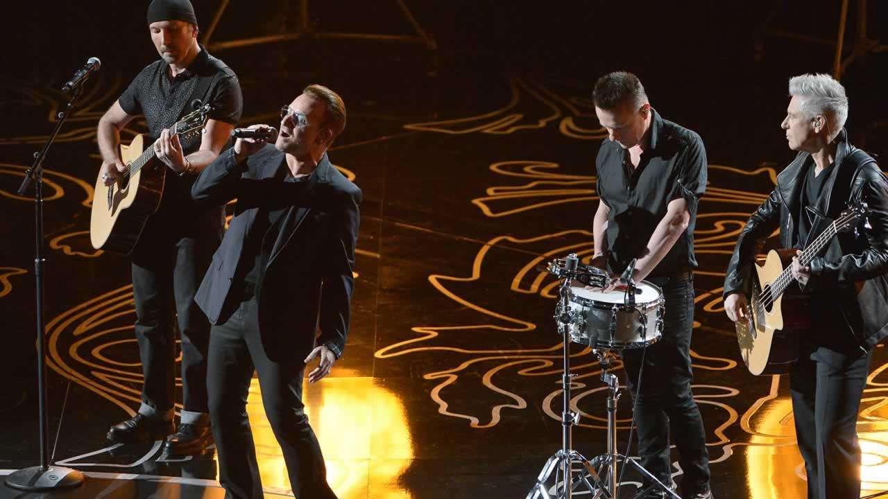 U2 performs on stage during the Oscars.