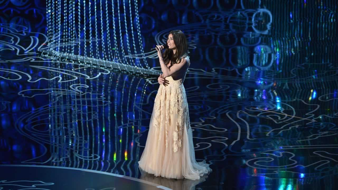 Idina Menzel performs on stage during the Oscars.