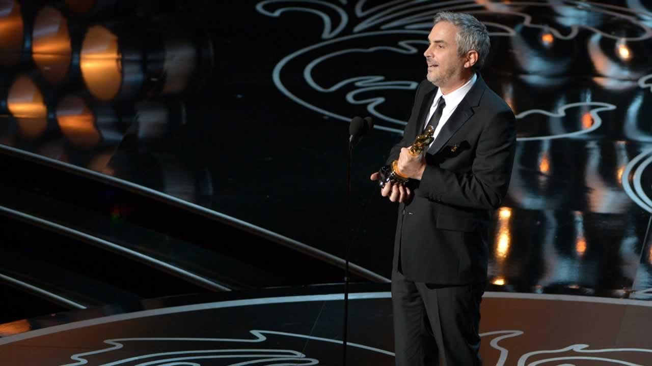 Alfonso Cuaron accepts the award for best director of the year for Gravity during the Oscars.