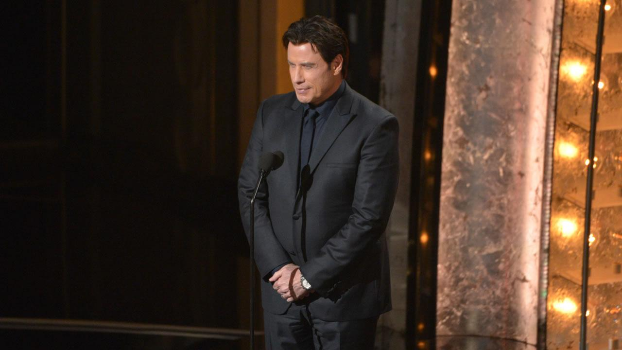 John Travolta speaks on stage during the Oscars at the Dolby Theatre on Sunday, March 2, 2014, in Los Angeles.