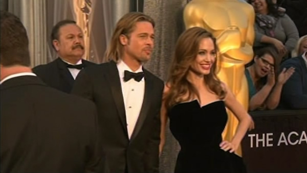 Brad Pitt and Angeline Jolie arrive before the 84th Academy Awards on Sunday, Feb. 26, 2012, in the Hollywood section of Los Angeles.