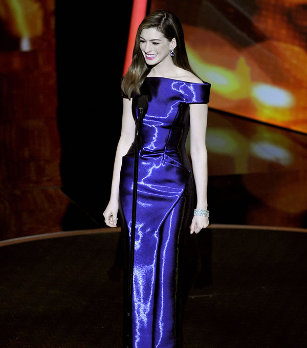 Show host Anne Hathaway is seen at the 83rd Academy Awards on Sunday, Feb. 27, 2011. (AP Photo/Chris Carlson)
