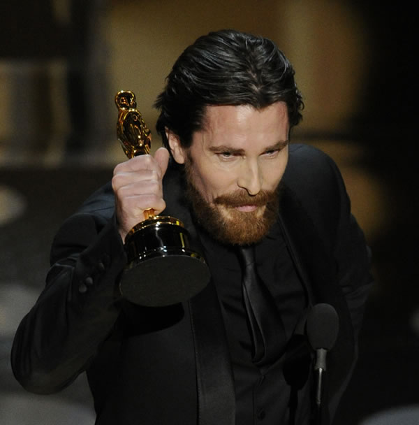 "Christian Bale accepts the Oscar for best performance by an actor in a supporting role for ""The Fighter"" at the 83rd Academy Awards on Sunday, Feb. 27, 2011, in the Hollywood section of Los Angeles. (AP Photo/Mark J. Terrill)"