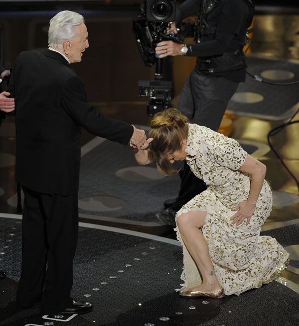 "Melissa Leo bows to Kirk Douglass as she accepts the Oscar for best actress in a supporting role for ""The Fighter"" at the 83rd Academy Awards on Sunday, Feb. 27, 2011, in the Hollywood section of Los Angeles. (AP Photo/Mark J. Terrill)"