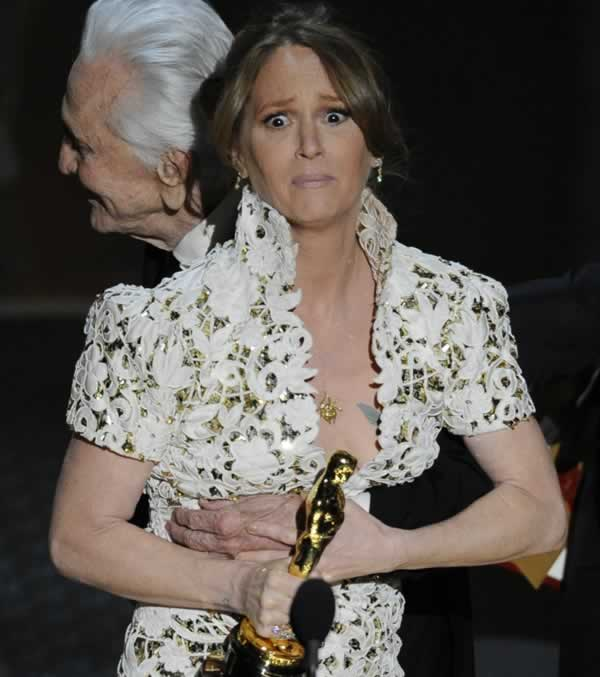 "Melissa Leo gets a hug from Kirk Douglass as she accepts the Oscar for best actress in a supporting role for ""The Fighter"" at the 83rd Academy Awards on Sunday, Feb. 27, 2011, in the Hollywood section of Los Angeles. (AP Photo/Mark J. Terrill)"