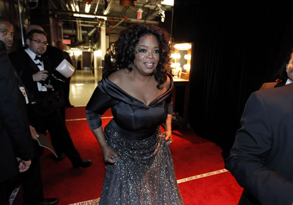 Best feature documentary presenter Oprah Winfrey at the 83rd Academy Awards on Sunday, Feb. 27, 2011, in the Hollywood section of Los Angeles. (AP Photo/Mark J. Terrill)