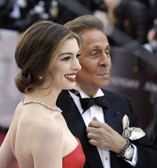 Actress Anne Hathaway, and designer Valentino arrive before the 83rd Academy Awards on Sunday, Feb. 27, 2011, in the Hollywood section of Los Angeles. (AP Photo/Amy Sancetta)