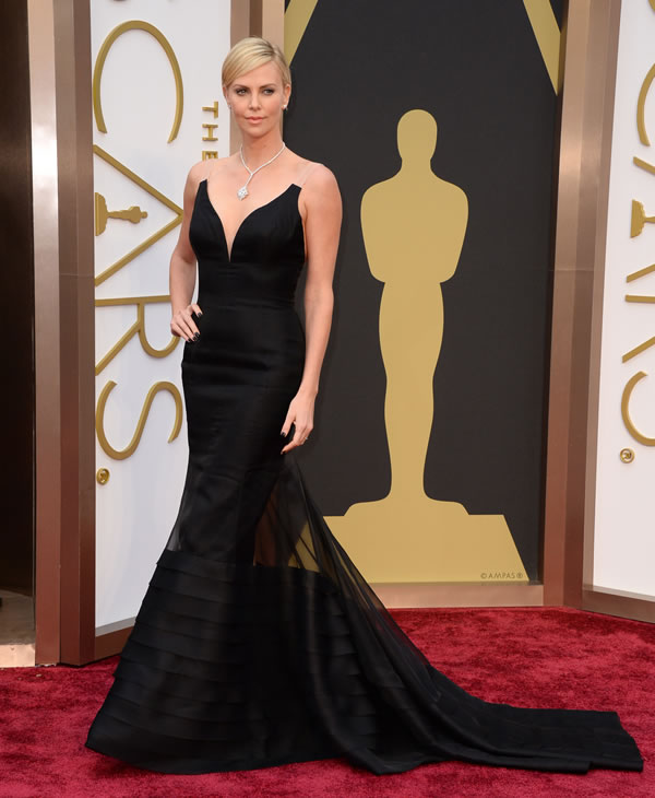 Charlize Theron arrives at the Oscars on Sunday, March 2, 2014, at the Dolby Theatre in Los Angeles. (Photo by Jordan Strauss/Invision/AP)