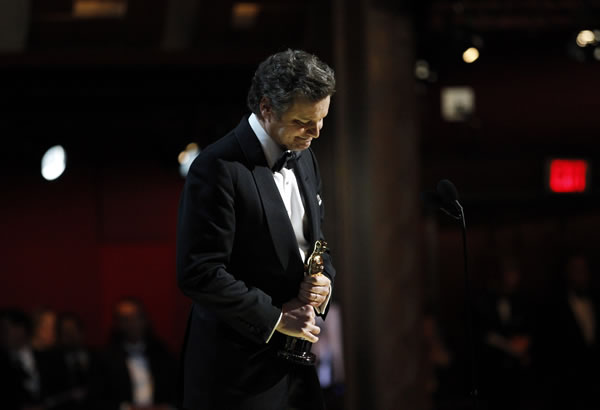 "Colin Firth accepts the Oscar for best performance by an actor in a leading role for ""The King's Speech"" at the 83rd Academy Awards on Sunday, Feb. 27, 2011, in the Hollywood section of Los Angeles. (AP Photo/Chris Carlson)"