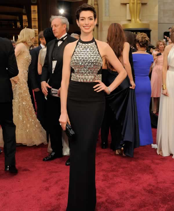Anne Hathaway arrives at the Oscars.
