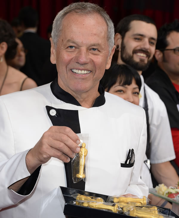 Wolfgang Puck arrives at the Oscars on Sunday, March 2, 2014, at the Dolby Theatre in Los Angeles. (Photo by Dan Steinberg/Invision/AP)