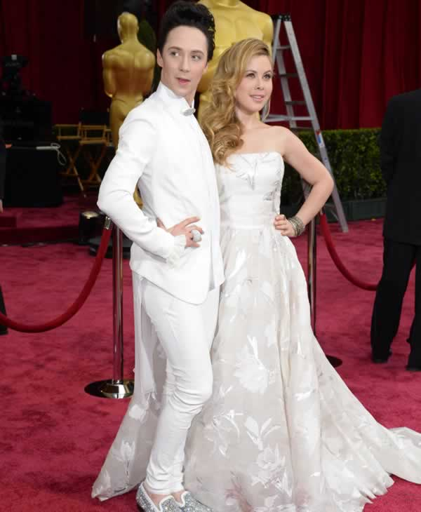 "<div class=""meta ""><span class=""caption-text "">Johnny Weir, left, and Tara Lipinski arrive at the Oscars on Sunday, March 2, 2014, at the Dolby Theatre in Los Angeles. (Photo by Dan Steinberg/Invision/AP)</span></div>"