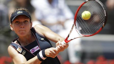 Romanias Simona Halep returns the ball to US Serena Williams during their semi final match at the Italian Open tennis tournament in Rome, Saturday, May 18, 2013. Williams won 6-3, 6-0. (AP Photo/Andrew Medichini)