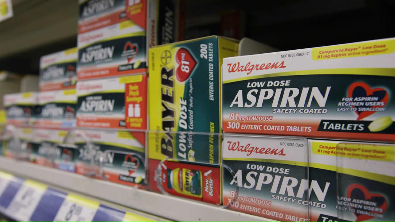Packages of aspirin fill the shelves of a drugstore, Tuesday, Aug. 11, 2009 in Chicago. A study suggests colon cancer patients who took aspirin reduced their risk of death from the disease by nearly 30 percent.