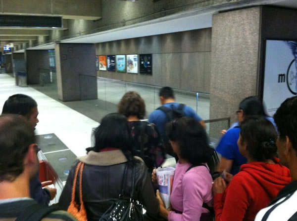 First BART riders streaming through fare gates at Embarcadero station on July 5th, 2013.  (Photo submitted by @HeatherIshimaru via Twitter)