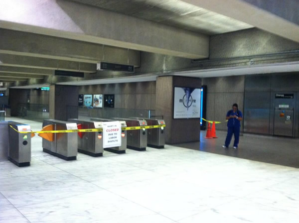 One woman at Embarcadero station waiting for BART to reopen on July 5th, 2013.  (Photo submitted by @HeatherIshimaru via Twitter)
