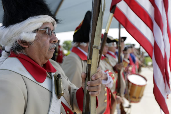 "<div class=""meta ""><span class=""caption-text "">Henry Alvarado, a member of the Granaderos y Damas de Galvez, stands at attention with other living history members during the national anthem during a Fourth of July Patriotic Ceremony at Fort Sam Houston National Cemetery, Thursday, July 4, 2013, in San Antonio. (AP Photo/Eric Gay)</span></div>"
