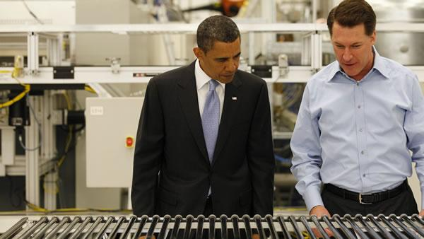 President Barack Obama, with Solyndra Chief Executive Officer Chris Gronet, looks at a solar panel, during a tour of Solyndra, Inc., a solar panel manufacturing facility, in Fremont, Calif. Wednesday, May 26, 2010.