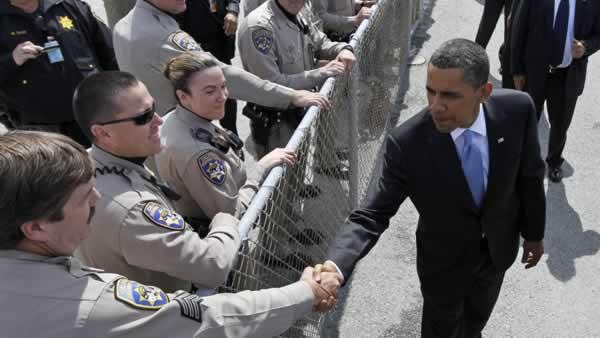 President Barack Obama shakes hands with members of the California Highway Patrol prior to boarding Air Force One in San Francisco, Wednesday, May 26, 20