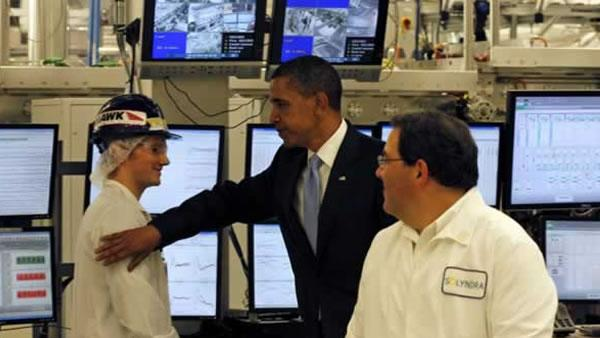 President Barack Obama pats a worker on the shoulder, as Solyndra Executive Vice President Ben Bierman looks on at right, during a tour of the solar panel manufacturing facility, in Fremont, Calif. Wednesday, May 26, 2010.