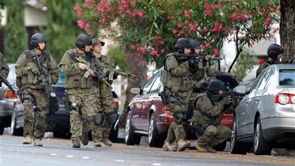 Police search a neighborhood in Cupertino, Calif., Wednesday, Oct. 5, 2011 looking for a shooting suspect.