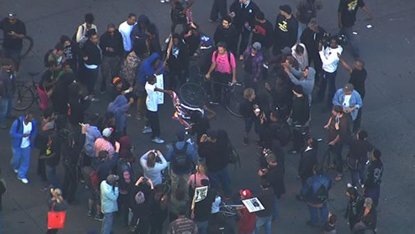 Demonstrators in Oakland set an American flag on fire during a rally for Trayvon Martin on Sunday.