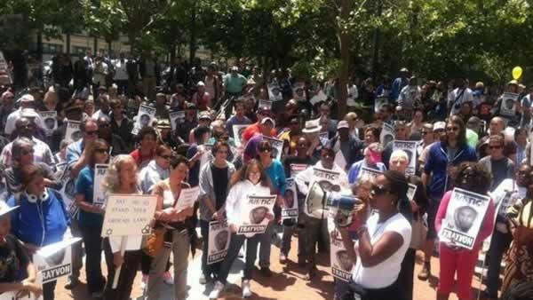 Hundreds rallied in Oakland on Saturday, July 20, 2013 to protest the verdict in the Trayvon Martin shooting case and to push for c