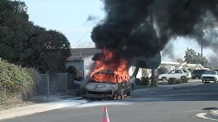 A pickup truck on fire