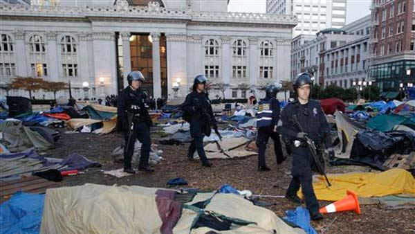 Police break up an encampment for a Occupy Wall Street demonstration in Oakland, Calif., Monday, Nov. 14, 2011.