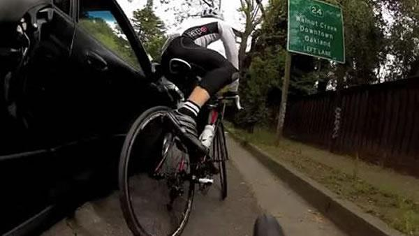 Video shows cyclist getting hit by car