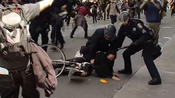 Oakland police officers and protesters clash during a May Day march in downtown Oakland (May 1, 2012/KGO)