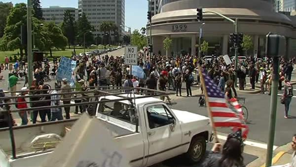 May Day protesters march in downtown Oakland