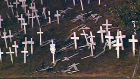 Someone knocked over as many as 20 crosses at a controversial memorial in Lafayette that honors fallen soldiers.