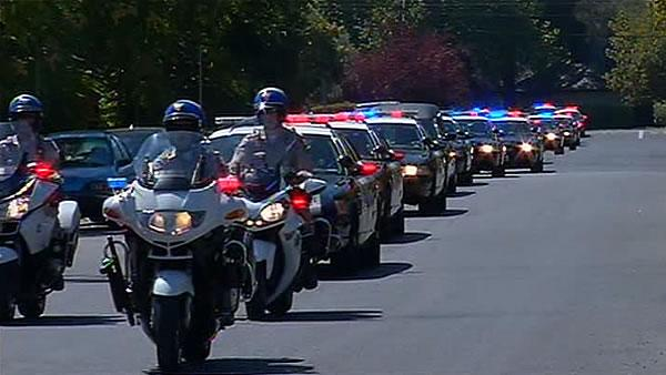 Motorcade procession escorts fallen CHP officer